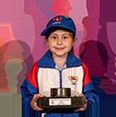 Emlyn receiving a trophy