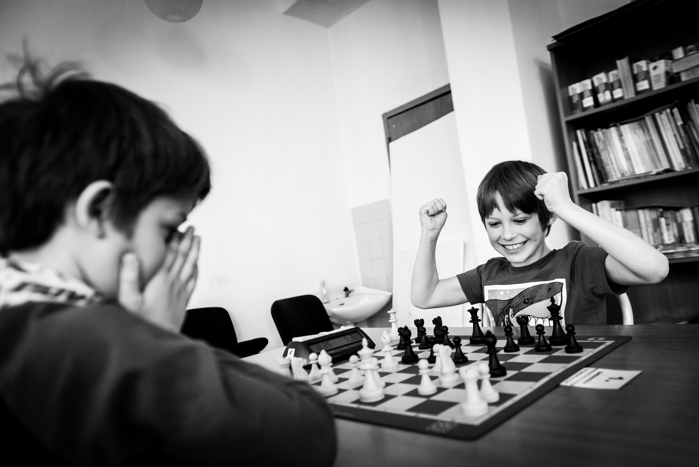 Student enjoying playing chess as they win